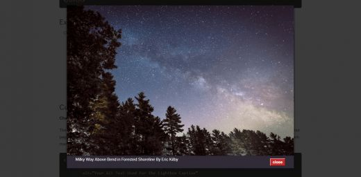 Milky Way Above Bend in Forested Shoreline By Eric Kilby